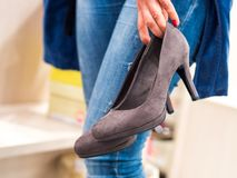 Woman trying high heels in a shop stock photo