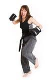 Woman wearing karate gloves Royalty Free Stock Photos