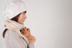 Woman wearing knit hat. Side view of a woman wearing knit hat Stock Images