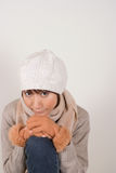 Woman wearing knit hat. Young woman wearing knit hat looking at camera Royalty Free Stock Image
