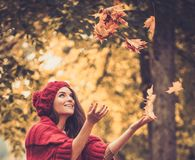 Woman wearing knitted coat in autumn park Royalty Free Stock Images