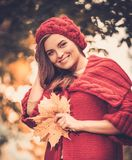 Woman wearing knitted coat in autumn park Stock Photo