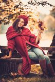 Woman wearing knitted coat in autumn park Stock Photos