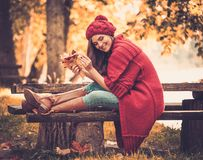 Woman wearing knitted coat in autumn park Royalty Free Stock Image