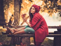 Woman wearing knitted coat in autumn park Royalty Free Stock Photography