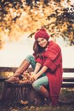 Woman wearing knitted coat in autumn park Royalty Free Stock Photos
