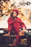 Woman wearing knitted coat in autumn park Royalty Free Stock Photo