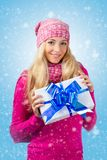 Woman wearing knitwear holding giftbox Royalty Free Stock Image