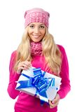 Woman wearing knitwear holding giftbox Stock Images