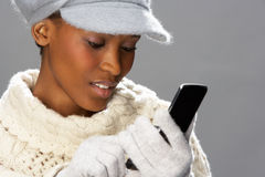 Free Woman Wearing Knitwear In Studio Using Mobile Royalty Free Stock Image - 15375566
