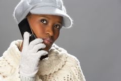 Woman Wearing Knitwear In Studio Using Mobile Royalty Free Stock Photography