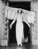 Woman wearing large headdress Stock Photography