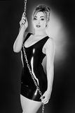 Woman wearing latex. Black and white image of woman wearing latex shot in the studio royalty free stock photo