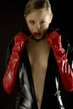 Woman wearing latex clothes Stock Image