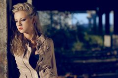 Woman wearing leather beige jacket Stock Images