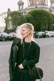 Woman Wearing Leather Jacket and Carrying Bag at the Parking Lot during Day Royalty Free Stock Photos