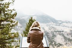 Woman Wearing Leather Jacket Facing Mountain Covered With Snow Royalty Free Stock Photo