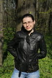 Leather jacket glasses woman Stock Photography