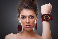 Woman wearing leather jewlery stock images