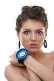 Woman wearing leather jewlery. Woman wearing blue leather earrings and bracelet over white stock image