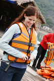 Woman wearing a life jacket Royalty Free Stock Images
