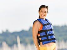 Woman wearing life jacket at beach Royalty Free Stock Images