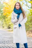 Woman Wearing Long Coat Outside in Autumn Royalty Free Stock Photo