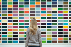 Woman Wearing Long Sleeve Facing Multi Colored Wall Stock Photography