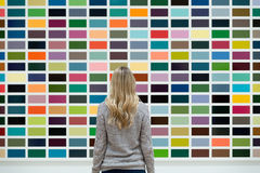 Woman Wearing Long Sleeve Facing Multi Colored Wall Royalty Free Stock Photography
