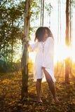 Woman Wearing Long-sleeved Shirt Standing Beside Tree Royalty Free Stock Image