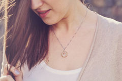 Woman wearing a luxury pendant Royalty Free Stock Photography