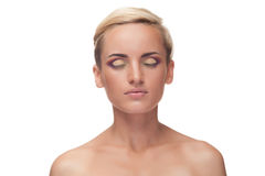 Woman wearing make up with closed eyes Royalty Free Stock Photo