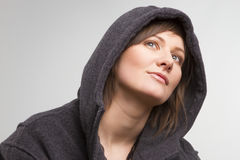 Woman wearing man's jacket Stock Photo
