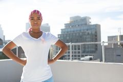 Woman wearing mantra scarf posing in city royalty free stock image