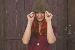 Woman Wearing Maroon Scoop-neck Shirt With Brown Knit Cap Royalty Free Stock Photos