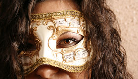 Woman wearing a mask Royalty Free Stock Photo