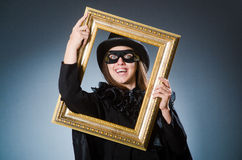 Woman wearing mask in art concept Stock Photos