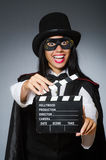 The woman wearing mask with movie board Stock Photography