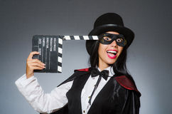 The woman wearing mask with movie board Royalty Free Stock Photo