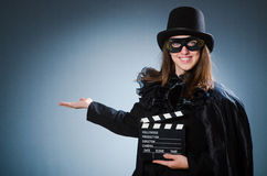 The woman wearing mask with movie board Stock Image