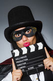 The woman wearing mask with movie board. Woman wearing mask with movie board Royalty Free Stock Image