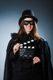 The woman wearing mask with movie board Royalty Free Stock Photography