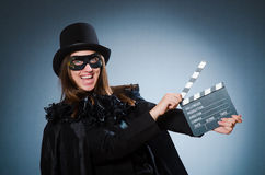 The woman wearing mask with movie board. Woman wearing mask with movie board Stock Image
