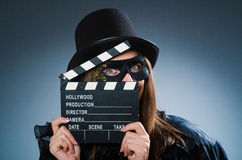 The woman wearing mask with movie board Royalty Free Stock Photos