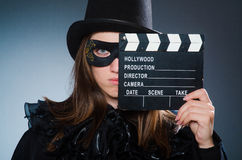 The woman wearing mask with movie board. Woman wearing mask with movie board Royalty Free Stock Images