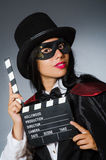 The woman wearing mask with movie board. Woman wearing mask with movie board Stock Photography