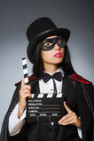 Woman wearing mask with movie board. The woman wearing mask with movie board Stock Photography