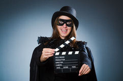 Woman wearing mask with movie board Royalty Free Stock Photography