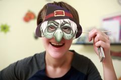 Woman wearing mask at halloween. Woman wearing a mask at a party halloween Royalty Free Stock Photo