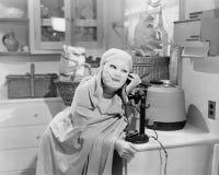 Woman wearing mask talking on phone Royalty Free Stock Photo